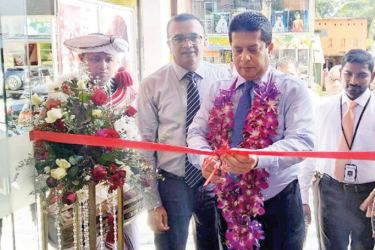 Lakshman Silva CEO, declaring the Kuruwita branch open. From L-R Achintha Hewanayake, Chief Operating Officer,  Lakshman Silva CEO, Chathura Devinda.Branch Manager