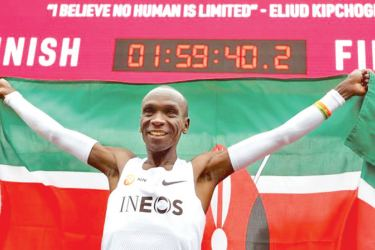 Kenya's Eliud Kipchoge celebrates after a successful attempt to run a marathon in under two hours in Vienna, Austria, on Saturday.