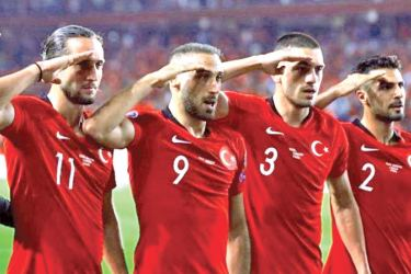Turkey footballers perform a military salute in their Euro 2020 qualifier against Albania.