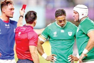 Ireland's Bundi Aki (second from right) is red carded in the match against Samoa.