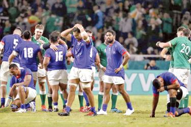 Samoa players look dejected after the match against Ireland.