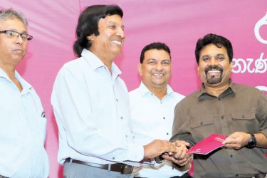 The Educational policy of National People's Power was unveiled by NPP Presidential candidate Anura Kumara Dissanayake at the Waters Edge in Battaramulla yesterday. Here, Dissanayake presenting the booklet containing the education policy of NPP to Prof. J.R.P Jayakodi, Department Physics, University of Kelaniya and other intellectuals. Picture by Saman Sri Wedage