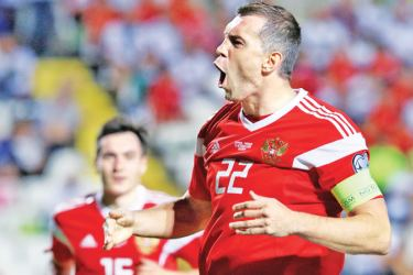 Russia's forward Artem Dzyuba celebrates his goal during the EURO 2020 group I qualifiers football match between Cyprus and Russia at the GSP stadium in the capital Nicosia on October 13, 2019. AFP