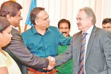 Minister Navin Dissanayake and investor Dopelme Cable Company, Switzerland exchanging the MoU