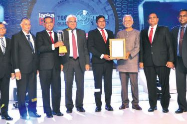 Award winners with officials of LankaPay Technnovation. Central Bank Governor Indrajit Coomaraswamy and Ambassador of Japan to Sri Lanka Akira Sugiyama are also in the picture. Picture by Wimal Karunathilaka
