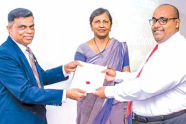 Director-General SLTDA, Upali Ratnayake Director of Standards & Quality Assurance,Tharanga Rupasinghe and Chairman of Jetwing, Shiromal Cooray presenting a certificate to a participant