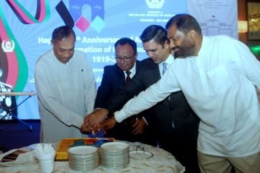 Special invitees cutting the anniversary cake Picture by Saliya Rupasinghe