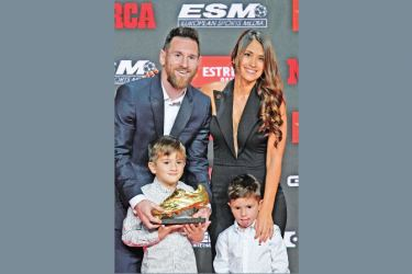Barcelona's Argentinian forward Lionel Messi (L) poses with his wife Antonella Roccuzzo and his sons Thiago and Mateo after receiving his sixth Golden Shoe award after receiving the 2019 European Golden Shoe honoring the year's leading goalscorer during a ceremony at the Antigua Fabrica Estrella Damm in Barcelona on Wednesday. AFP