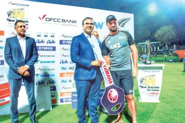 New Zealand's Colin Grandhomme receiving the key To Yamaha motor cycle