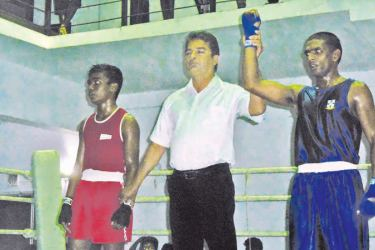 P.V.S Himanjith of S. Thomas' College, Mount Lavinia is declared the winner of the bout against J.K.N.T. Nethmina of Narandeniya CC in a Fly weight contest in the Stubbs Shield Boxing Championship at Jayathilaka Stadium in Nawalapitiya