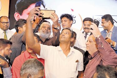 SELFIES BY THE PEOPLE:NDF presidential candidate Minister Sajith Premadasa  posing for selfies at the business forum held at the Shangri-La Hotel yesterday.Picture by Rukmal Gamage.