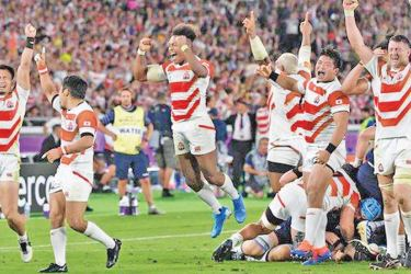 Japan celebrate beating Scotland to reach the World Cup quarter-finals for the first time.