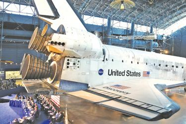"""The Space Shuttle Discovery is the back drop as U.S. Vice President Mike Pence chairs the 6th meeting of the National Space Council on """"Leading the Next Frontier"""" at the National Air and Space Museum, Steven F. Udvar-Hazy Center, August 20, 2019 in Chantilly, Virginia."""