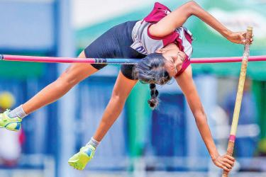 N. Dadsitha of Hindu College, Chavakacheri sets a new meet record of 3.35m in the Under 20 Pole Vault.