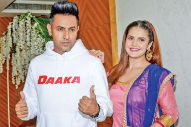 Bollywood actress Zareen Khan and actor Gippy Grewal pose for photographs during the promotion of the upcoming Punjabi film 'Daaka' in Amritsar