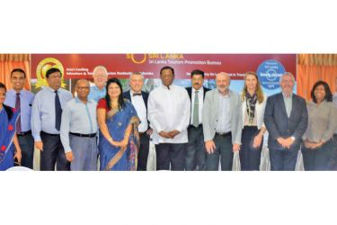 Minister of Tourism John Amaratunge with  Belgium Touring members in Colombo yesterday. Picturee by Sudath Malaweera