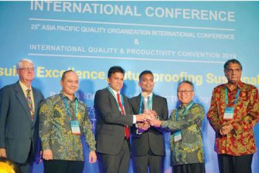 Asitha Samaraweera and Viraj Jayasooriya, Managing Director and Director Operations at Atlas Axillia Co. accept the prestigious Global Performance Excellence Award 2019 on behalf of the Company at the GPEA 2019 Awards Ceremony hosted by the Asia Pacific Quality Organization in Bali, Indonesia.