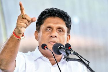 New Democratic Front candidate Sajith Premadasa addressing a public rally at Gampola on Saturday. Picture by Hirantha Gunathilake