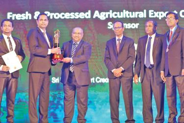 Dr. Ruwan Wathugala, Managing Director of Royal Cashews group receives the NCE Gold Award, Nimal Ananda, General Manager and RuwanLahiru Danthanarayana,  New Product Development and Research Manager of Royal Cashews group also in the picture.