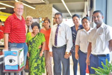 SPAR Sri Lanka Operations Manager Craig Hall receives a HelpAge charity till from HelpAge Executive Director Samantha Liyanawaduge.  HelpAge Officials Ruchilalani Batuwanmthudawa, Manoji Galappaththi, Tissa Silva and Priyadharshani Bulathsinhala are also in the picture.