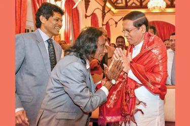President Maithripala Sirisena is received by veteran singer Surya Kumara Muththalage. Picture courtesy President's Media Division