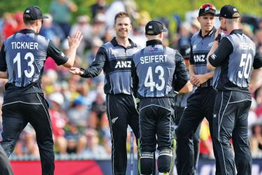New Zealand's Lockie Ferguson (C) celebrates with teammates after bowling England's Lewis Gregory during the Twenty20 cricket match between New Zealand and England at Saxton Oval in Nelson on November 5. AFP