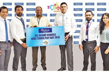 Presenting the sponsorship of the 'All Island Schools Kids Tennis Play Day 2019' is Nilupul de Silva, General Manager, Marketing, CBL Foods International (Pvt) Ltd (centre right) to Ganendran Subramaniam, Tennis Professional of the Sri Lanka Tennis Association (centre left). Also pictured are officials from CBL and Sri Lanka Tennis Association.