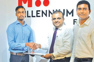 Indika Dalugama, Director, STEMUp Educational Foundation exchanges the partnership with Dr. Sajeeva Narangoda, Director and Chief Operating Officer, MillenniumIT ESP and Chief Investments and Process Officer Ambeon Holdings PLC,  Sanjaya Dayananda Head of Business Applications, MillenniumIT ESP