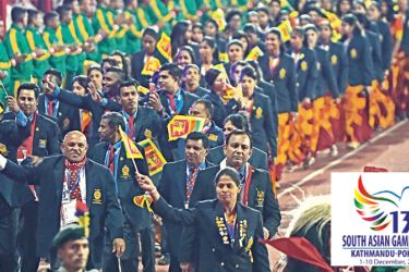 The Sri Lanka contingent take part at the opening ceremony of the 13th South Asia Games at Kathmandu, Nepal yesterday.