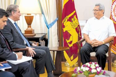 STRENGTHENING BONDS: Pakistani Foreign Minister Shad Mahmood Qureshi called on President Gotabaya Rajapaksa at the Presidential Secretariat yesterday.Picture courtesy President's Media Division