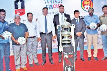 """FFSL donated """"TOTO"""" brand balls to VANTAGE FA Cup clubs who advanced to final Round of 32, during the Press Conference held at Football House recently. The Chairman of Competition Committee Zaharan Singhawansa, President of FFSL Anura de Silva, Marketing Manager of Ebony Holdings(Pvt) Ltd Mohamed Musfir and General Secretary of FFSL Jaswar Umar are also in the picture. Picture by Herbert Perera"""