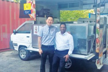 TRUCKNET CEO Adren Chong with Chairman Ihthisam Holdings, Abul Mawahib in Malaysia