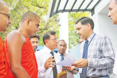 Representatives of the People's Responsibility Center hand over the letter to a UN official at the UN country office in Colombo yesterday. Picture by Saman Sri Wedage