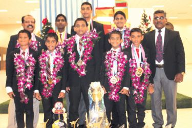 The Nalanda Karate team is seen here along with the two coaches on their return to the country at the Katunayake International Airport