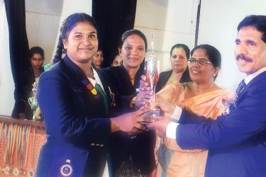 A. D. Wasana Mendis receives the Best Woman Athlete's Cup at the Kalutara Zonal Inter-School Colour Awards Ceremony, from WP Education Director Srilal Nonis and Kalutara Zonal Education Director O. M. V. Priyani Mudalige (Center) Kalutara Zonal Asst. Director of Education (Sports/Physical Education) Dimuthu Surangi Kokuge are also present (Pic by Kalutara Central Special Corr. H. L. Sunila Shantha)
