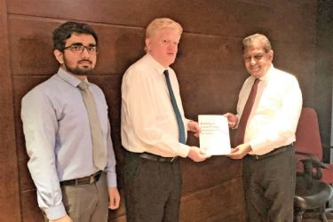Managing Director, Rohan Senanayake and Mashood Nazraar, Senior Financial Analyst of K Seeds Investments, presenting the report to the Managing Director of LB Finance, Sumith Adhihetty.