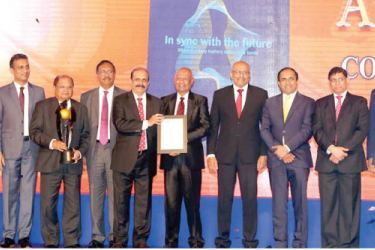 Commercial Bank Chairman Dharma Dheerasinghe, Deputy Chairman Preethi Jayawardena and representatives of the corporate and senior management with the awards presented to the Bank at the CA Sri Lanka Annual Report awards