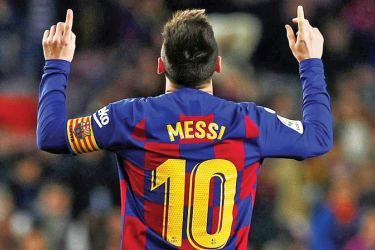 Barcelona's Lionel Messi celebrates scoring their fifth goal to complete his hat-trick.