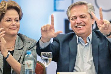 "Argentinian President-elect Alberto Fernandez flashes the ""V"" -for victory- and the ""L"" -for Brazilian former President Luiz Inacio Lula da Silva- signs next to Brazilian former President Dilma Rousseff (L) during the opening of the second meeting of Puebla Group in Argentina, on November 9, 2019. - AFP"