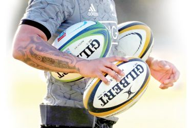 The tattooed arm of a New Zealand's All Blacks player is seen during their training session in Urayasu, east of Tokyo, Japan.