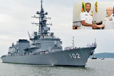 Japanese Naval ship DD-102 Harusame arrived at the Trincomalee Port yesterday. Inset: Commanding Officer of the ship Commander Ohshima Teruhisa with Deputy Area Commander of the Eastern Naval Area, Commodore Sanjeewa Dias. Pictures courtesy SL Navy.