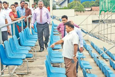 Minister of Education, Sports and Youth Affairs Dullas Alahapperuma ordering the officials to clean up the Sugathadasa Stadium sports complex