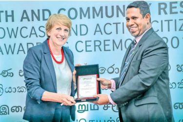 Awarding of Token of Appreciation by Country Director - Muslim Aid to British Council Sri Lanka Country Director Gill Caldicott.
