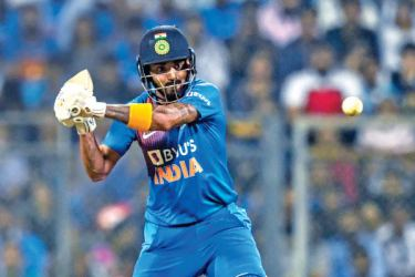 India's Kannaur Lokesh Rahul plays a shot during the third T20 international cricket match against West Indies at the Wankhede Stadium in Mumbai on Wednesday. - AFP