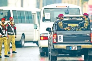 Security personnel escort a convoy transporting Pakistan's and Sri Lankan cricketers to the Pindi Cricket Stadium before the start of the first day of the first Test cricket match in Rawalpindi on Wednesday.  – AFP