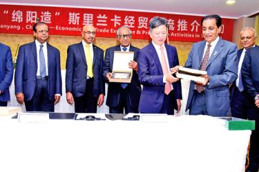 From left: Secretary General Mianyang Association of Commerce Ms Yuan Wenyan, Chairman Mianyang Association of Commerce Zhang Zhongcheng, Sri Lanka's State Minister of International Cooperation Susil Premajayantha (who witnessed the signing of the two Agreements) and COSMI founding member Hui Dias Bandaranayake (far right), and other Lankan business, industry leaders look on as Chairman, Mianyang Enterprise Union for Import and Export John Luo (fifth from right) and COSMI Founder President Nawaz Rajabdeen (