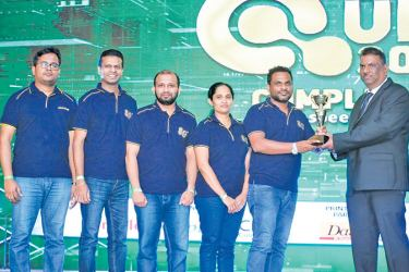 A.T. Kumarawadu (team leader) receives the award for the 1st runner-up from J.P.R. Karunaratne Deputy Governor of CBSL. Other members of the winning team A.M.K.P. Adhikari, L.S. Gamlath, G.P. De Silva and S.K. Liyanage is in the picture