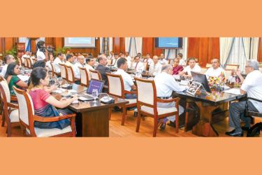 BRIEFING: President Gotabaya Rajapaksa addressing senior Transport Ministry officials at the Presidential Secretariat yesterday. Minister Mahinda Amaraweera, State Minister Dilum Amunugama, Secretary to the President Dr P. B. Jayasundera and Defence Secretary Major General (rtd) Kamal Gunaratne were present. Picture by President's Media.
