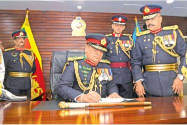 Acting Chief of Defence Staff Shavendra Silva signing the official documents. Picture by Rukmal Gamage.