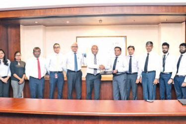 Dimantha Seneviratne – Group Chief Executive Officer/ Director ( NDB) and Mahesh Nanayakkara - Managing Director / Chief Executive Officer (CDB) exchanging the agreement looked on by officials of NDB and CDB